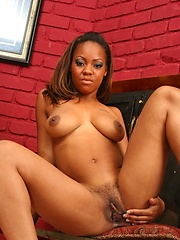 A black cutie with awesome tits gets her pussy tapped