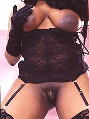 Appetizing ebony BBW in black stockings