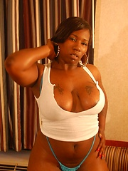 Sexxi plays with her big black tits