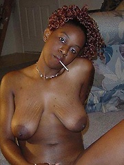 Black chick Shyshy shows her shaved pussy