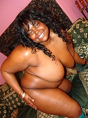 Voluptuous ebony babe show off her big fat tits and gets her pussy balled by a horny white guy