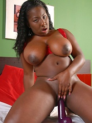 Candy black girl Luxury Amore with jumbo juggs plays with her dark pussy