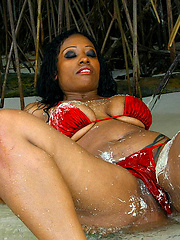 Wet sand and wet black pussy