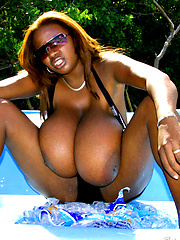 Melting ice and big black tits