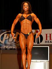 Musled black woman posing