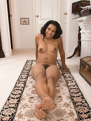 Divine strips naked to lay on her rug